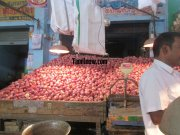 Heap of onions for sale at koyambedu vegetable market 154