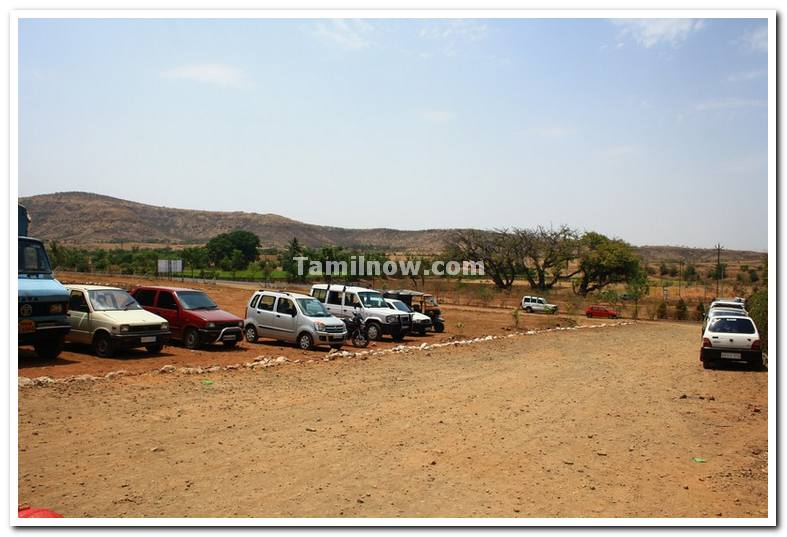 Vehicles parked near waterpark dandoba