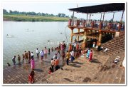 Bath in holy river sangams
